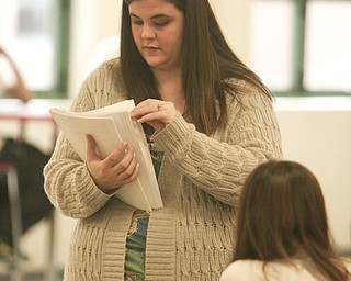Ericka Eckert, a permanent substitute teacher at Chaney High School, prepares to distribute class work. About 820 are enrolled at the West Side high school although some juniors and seniors attend Choffin Career and Technical Center part of the day.