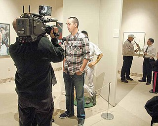 Pittsburgh Pirate Jeff Karstens (foreground) and pitching coach Ray Searage (background) are interviewed by members of the media yesterday afternoon at the Butler Institute for American Art.