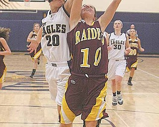 (10) Mckenzie Pfeifer of South Range glides to the hoop as (20) Crystal Richards goes for the block Thursday night.