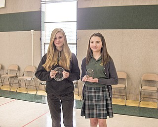 """After correctly spelling the words """"courteous"""" and """"brilliant"""" to become the spelling bee champion on Jan. 21 at Holy Family School, Olivia Morrison, at left, and Francesca Strollo, the runner-up, display their trophies."""