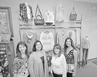 MARK STAHL | THE VINDICATOR: Displaying items they have chosen for the style show to be presented by La Ti Da Boutique at the Champagne Brunch and Fashion Show on Feb. 25 are, from left, Shelly Barton, Tammy Engle, Cassi Calderon and Susan Yarab, members of the Mahoning County Medical Society Alliance.