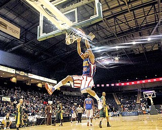 Harlem Globetrotter Hacksaw Hall wows the audience at the Covelli Center with multiple high flying dunks Saturday afternoon.