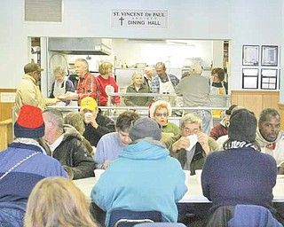 Volunteers serve lunch for needy people at St. Vincent DePaul Society Dining Hall in Youngstown. In 2010, the facility served 91,000 meals