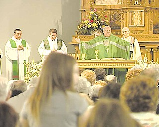 Bishop George V.  Murry delivers the final mass at Immaculate Conception Church in Youngstown.
