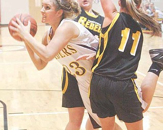 Gab Naples (23) splits defendersGerie Sickle (14) and Morgan Newbauer (11) to score Monday night in South Range.