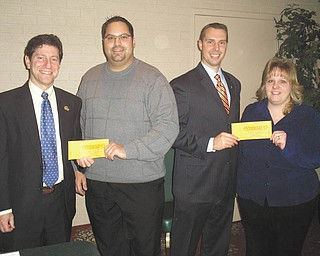 Gearing up for reverse raffle: Austintown Rotary Club will host its primary fundraiser, an evening of fine food, beverages and desserts, at 6:30 p.m. March 5 at the Maronite Center on Meridian Road, Youngstown. Those attending the event will have an opportunity to participate in a reverse raffle for a chance to win part of $2,000 in cash prizes. Tickets for the event are $150 per couple and include dinner for two, refreshments and a chance to win prizes. There also will be a mini board raffle; tickets are $25 each. Preparing for the sale of raffle tickets are, from left, Dr. Mitch Dalvin, Dr. Michael Cafaro, Brian Laraway and Melissa Crowley, Austintown Rotarians.