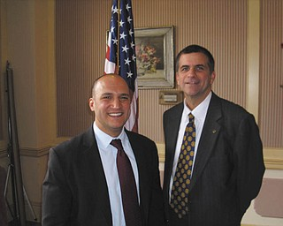 Time for a change: At the Jan. 26 meeting of Youngstown Rotary Club, Ohio state Sen. Joe Schiavoni, D-33rd, presented a synopsis of the ideas and programs that have been proposed to help cut the state's budget, to reduce Ohio's joblessness and to stimulate the slow economy. He spoke of the new state Congress and Ohio's new governor John Kasich and stressed the need for the political parties to work together. He said that redistricting needs to be done because of the loss of two representatives at the federal level. He also spoke of the need for stronger education for the young, and the need for grants to help businesses expand and provide more jobs. Following his talk Sen. Schiavone, at left, is joined by Steve Kristen, Rotary Club president.