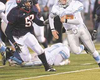 Hot Pursuit as Fitchs Steve Zaborsky (53) as he closes in on the Rebels QB Ray Russ (7) in the first round of playoffs.