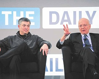 Rupert Murdoch, right, Chairman and CEO of News Corporation, and Eddy Cue, vice president of Apple, attend the launch of The Daily, Wednesday, Feb. 2, 2011 in New York. The Daily is the world's first iPad-only newspaper.
