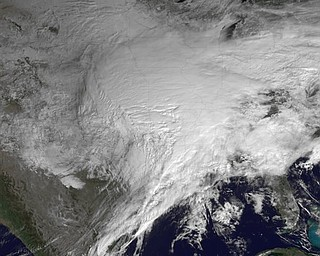 This satellite image provided by NOAA and taken Tuesday Feb. 1, 2011 at 10:45 EST shows a huge swath of the United States affected by a winter storm that has already brought layers of dangerous ice and blowing snow, closing roads and airports from Texas to Rhode Island. The storm's more than 2,000-mile reach threatened to leave about a third of the nation covered in a hodge-podge of harsh weather. Ice fell first and was expected to be followed by up to two feet of snow in some places.  (AP Photo/NOAA)