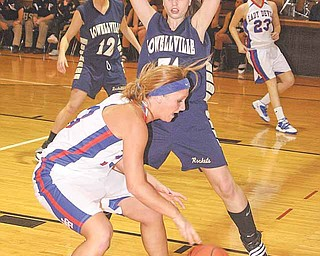 Lowellville's Rachel Durbin (31) defends Western Reserve's Tori Korda (33) during a basketball game Thursday in Berlin Center. The Rockets needed overtime to defeat the Blue Devils, 65-59.