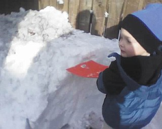 Timmy Kerr, 4, of Poland enjoys the weather. Photo sent in by Gary Kerr.