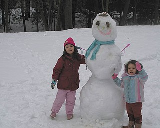"Ella Earnheardt, 5, and Kate Earnheardt, 3, of Liberty Township didn't just build a snowman. They got creative and built a snow ""princess."" Photo sent in by their dad, Adam Earnheardt of Youngstown."
