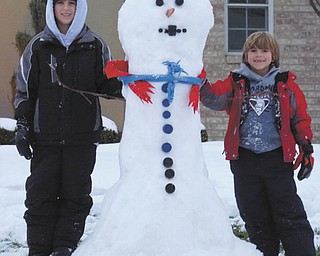 Ivan and Alec Bosnjak of Boardman show off one well-dressed snowman. Photo submitted by their parents, Andrea and Ivan Bosnjak.