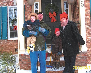 Matt, Meg, Vaughn and Riley Manning of Nashville, Tenn., hang out on their porch during one of many snowfalls this year. Photo sent in by proud grandparents Phyllis and Don Manning of Canfield.