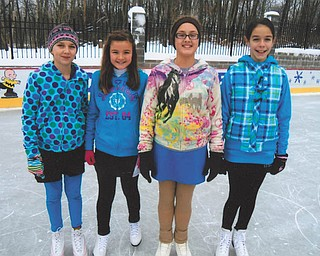 Alesha, Bethany, Olivia and Allison, all of McDonald, enjoy an afternoon of skating at the ice rink built by Rick and Laura Glass on their property in McDonald.