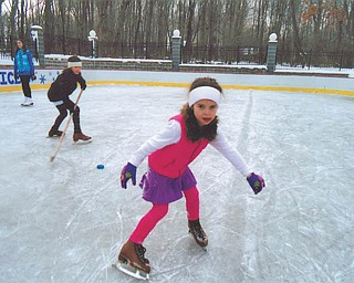 Maria Constantino of McDonald shows off her skating skills during a recent outing to the ice rink built by Rick and Laura Glass on their property in McDonald.