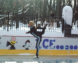 Laura Glass glides along the ice rink she and her husband, Rick, built on their property in McDonald in 2005.