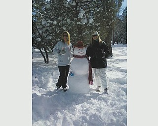 On New Year's Day 2011, Cheri Fisher of Phoenix, Ariz., and Shanna Bradley of Queen Creek, Ariz., built this snowman in the mountains of Happy Jack, Ariz., just a two-hour drive from sunny Phoenix. Photo sent in by Cheri's mom, Peg Sigle of Boardman.