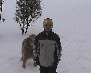 Evan and his dog Brady spend time playing in the snow.