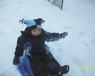 18-month-old Jimmy Putko from Boardman has a blast sledding for the very first time.