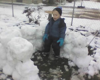 Timmy, 4, of Poland takes a break while building a snow fort. Photo submitted by Gary Kerr.