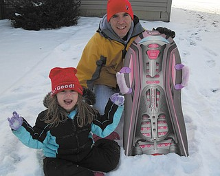 McKenna Sweeney, 6, has a blast with her dad, Michael, as they go sledding in his parents' back yard. Photo sent in by Marnee Sweeney.