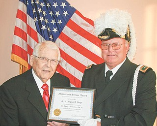 Leland E. Clegg, left, received a 60-year service pin and certificate when Knights Templar honored him for his long dedicated service to Masonry. Dale Hawkins, eminent commander of St. John's No. 20, Knights Templar Commandery of Youngstown, presented the award at a recent banquet for the York Rite Bodies of Masonry.