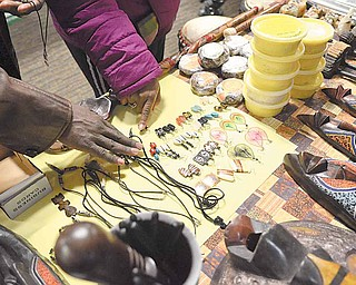 Shoppers examine merchandise for sale at the African Marketplace. Jewelry, clothes, books and art were among the offerings.