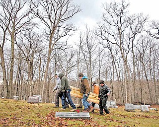 Friends and neighbors of Betty Lou Davis, 79, of Athens County carry her in a homemade coffin that they made a few days earlier to her final resting place at Stewart Cemetery.  She died last Saturday and the family had no money for her funeral. Friends built her a coffin, dug the grave, and had the funeral, Saturday, February 5, 2011.