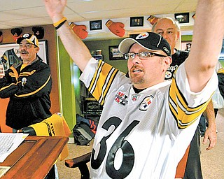 Steelers fans celebrate in the basement of Jim Davis of Austintown while watching the Steelers score a touchdown in Super Bowl XLV.
