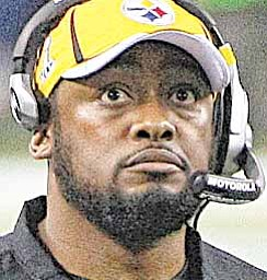 Pittsburgh Steelers head coach Mike Tomlin watches the scoreboard during the first half of NFL Super Bowl XLV football game against Green Bay Packers, Sunday, Feb. 6, 2011, in Arlington, Texas.