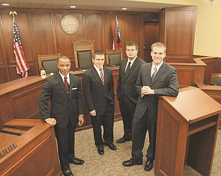 Members of Youngstown State University's Moot Court Team, from left, James Toliver of Youngstown, a sophomore; and Mark Cornman, Travis Watson and Kevin Hulick, all juniors from Austintown; traveled to Tulane University in New Orleans last month to compete in the American Collegiate Moot Court Association's national competition.