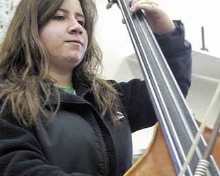 Boardman High School 10th grade band member Alyssa Vivacqua plays bass during a practice.