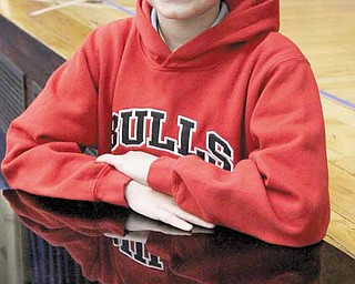 "In this photo taken Jan. 11, 2011, Erik Yehl, 11, smiles in the auditorium of his school in Chicago. Yehl, who has been stuttering since preschool, said the film ""The King's Speech"",  about a stuttering monarch, was sometimes tough to watch, because it hit so close to home. The award-winning film reveals myths and fascinating truths about stuttering, and has won praise from stutterers of all ages."