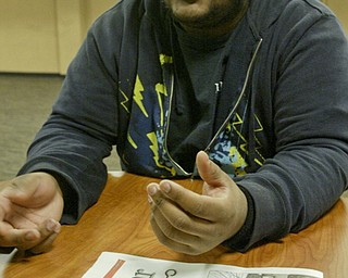 William D. Lewis the vindicator YSU student Dezmond Riley talkse about a shooting off campus. pixed on campus Monday 2-7-11