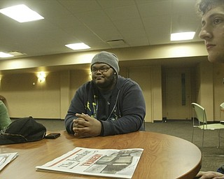 William D. Lewis the vindicator YSU students l-r .Steve Bada, Dezmond Riley and Ralph Rich talk about a shooting during an off campus party . Pixed on campus Monday 2-7-11