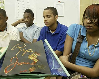 Woodrow Wilson Middle School eighth graders, from left, Allen Torres, Ramses Terry, Charles Dorsett Jr. and Jo'Nell Jackson, talk about Jamail Johnson, a Youngstown State University student killed in a weekend shooting. Johnson worked as a math tutor at the school and students wrote letters, created cards and made posters in his memory.