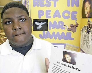 Jerrell Shorter, an eighth-grader at Woodrow Wilson Middle School, shows a letter he wrote to the late Jamail Johnson, the YSU student who died in Sunday's shootings.