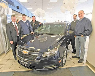 Debby Blalock of Canfield won a two-year lease on this new Chevrolet Cruze donated by Greenwood Chevrolet in Austintown, an incentive for the 2010 fundraising campaign for United Way of Youngstown and the Mahoning Valley. The United Way exceeded its $2.5 million goal. Surrounding the grand prize are, from left, Bill Padisak, chairman of the UW's trustee board; David Green, president of United Auto Workers Local 1714, Lordstown, where the Cruze is made; Bob Parcell, General Motors Lordstown plant manager; Bill Piechocki, GM personnel director; and Jim Graham, president of UAW Local 1112.