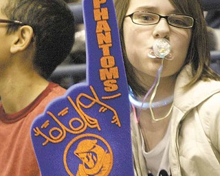 Irene Denney, a 6th grader from Niles, shows her team spirit during a Phantoms Hockey game Wednesday morning at the Covelli Center. The Phantoms took on the Indiana Ice in a 10 a.m. game with school children from the area attending.