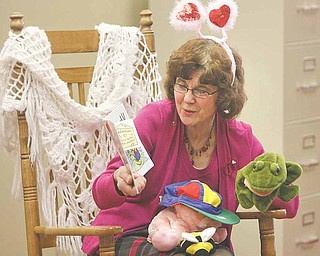 Maria Selak, childrens librarian at the Girard Free Library, donned hearts to help illustrate the Valentine's Day theme of storytime Wednesday at the library. Children also got to make a craft and get a snack.