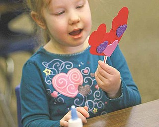 Molly Durkin, 4, works on her Valentine mouse after Valentine storytime at the Girard Free Library Wednesday.