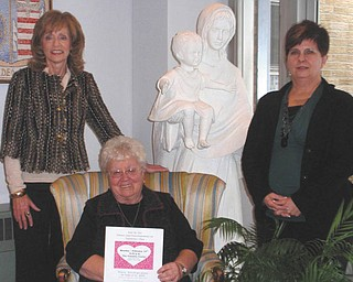 A special valentine event: A Valentine's Day dinner and evening of entertainment have been planned for 6:30 p.m. Monday at the Ursuline Center, 4280 Shields Road in Canfield Township, as a benefit for the center. Pianist Thomas Solich will provide dinner music, and the Ursuline High School Chorus will entertain after the dinner. The gourmet meal will feature a Valentine theme and a chocolate fondue dessert. Standing, from left, Joan Sonnett and Becky Fisher approve the menu held by Sister Nancy Dawson, general superior for the Ursuline Sisters of Youngstown. Tickets cost $22 each or $200 for a table of 10. For tickets or additional information call the center at 330-799-4941.