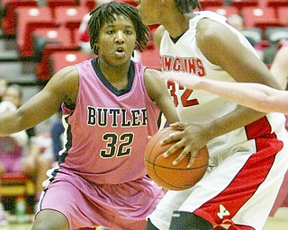Youngstown State's Tiera Jones (32) tries to get around Butler's Chloe Hamilton (32 pink) during Thursday's Horizon League game at YSU's Beeghly Center. The  Penguins were unable to stop Hamilton, who scored 34 points to lead the No. 2 Bulldogs to a 73-56 win. Jones had 12 points for YSU.