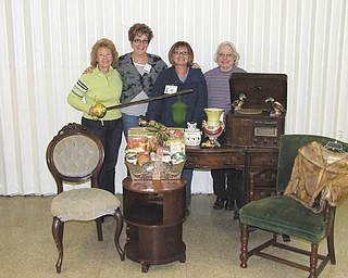 From left, Junior Group of Goodwill volunteers Patty Suchora, Kathy Gerberry, Sue Miller and Shirley Rodgers display items to be auctioned off during the 19th annual Junior Group of Goodwill Antique and Collectibles auction on March 5. The two-day event begins with a gala on March 4, which includes a jewelry sale, live auction of new items a basket raffle, silent auction and a basket auction.