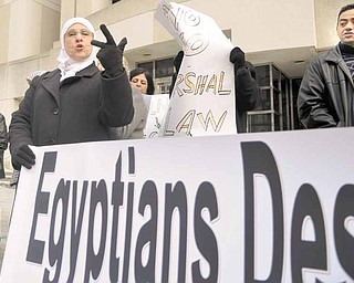 "Amal Ilain of Youngstown was one of about 40 demonstrators who celebrated Egyptian President Hosni Mubarak's resignation Friday in downtown Youngstown. The banner read, ""Egyptians Deserve Democracy."""