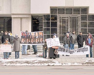 Demonstrators from the Arab American Cultural and Education Center gather at the Thomas Lambros Federal Courthouse in downtown Youngstown to celebrate Hosni Mubarak's resignation as president of Egypt.
