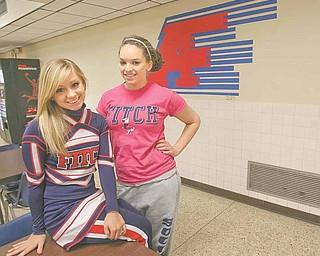 Joellin Chance and Elan Caruso, both officers for the junior class at Fitch High School, helped raise money Friday for an Austintown family whose son, Jesse Sellars, died last week. The money will be given to the family to help with funeral costs.
