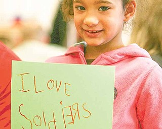 Alaina Moody proudly shows off the Valentine's Day card that she and her military partner made for troops in Afghanistan.